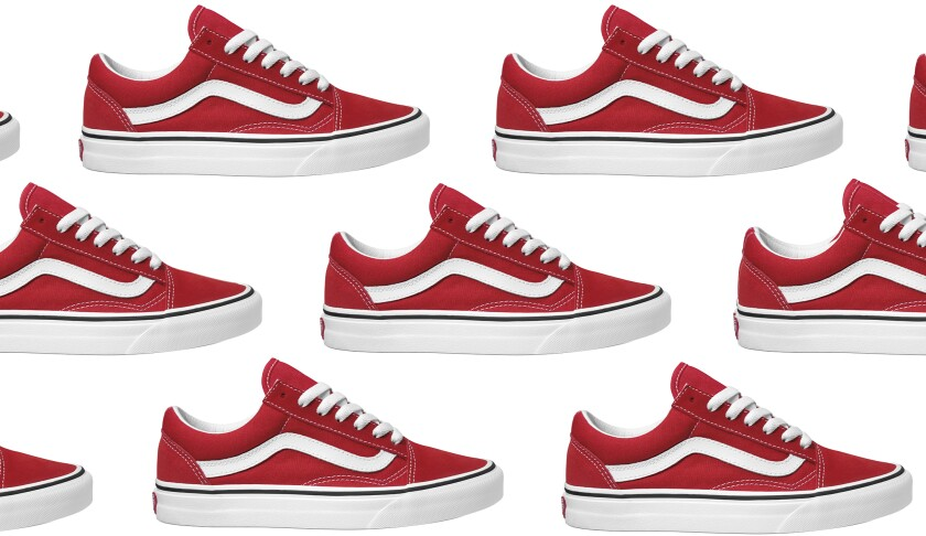 A photo of a red lace-up sneaker with a white sidestripe.