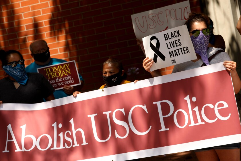 Protesters demonstrate in front of the USC Department of Public Safety to abolish the campus police force