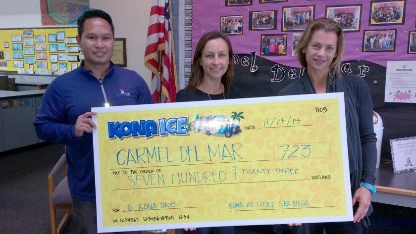 John Rodriguez of Kona Ice Little San Diego presents a check to Carmel Del Mar School.