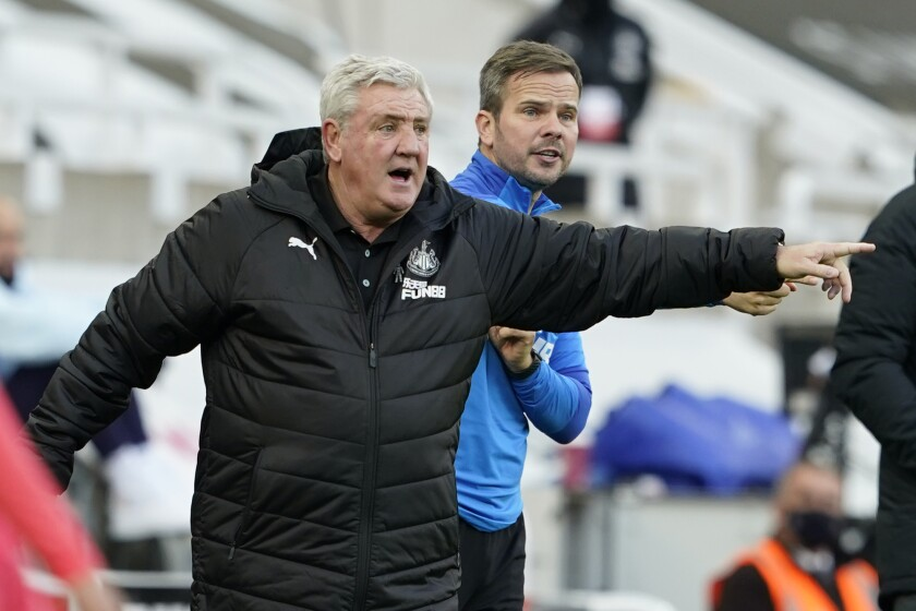 Newcastle's head coach Steve Bruce gestures during the English Premier League soccer match between Newcastle United v Chelsea at the St. James' Park in Newcastle, England, Saturday, Nov. 21, 2020. (Owen Humphreys/Pool via AP)