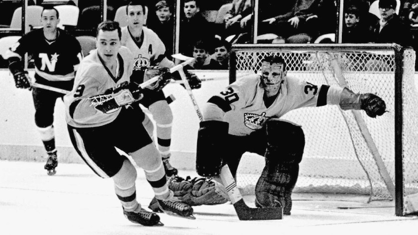 Goalie Terry Sawchuk of the Los Angeles Kings moves to make a save during an NHL game against the Minnesota North Stars circa 1967 at the Met Center in Bloomington, Minn.