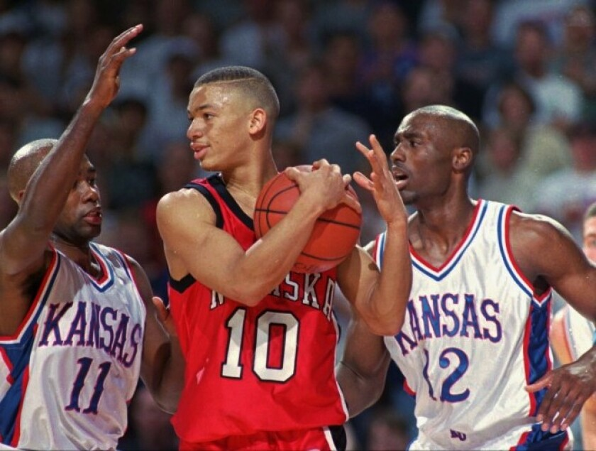 Nebraska's Tyronn Lue is sandwiched between Kansas' Jacque Vaughn (11) and Billy Thomas during a game Feb. 1, 1997.