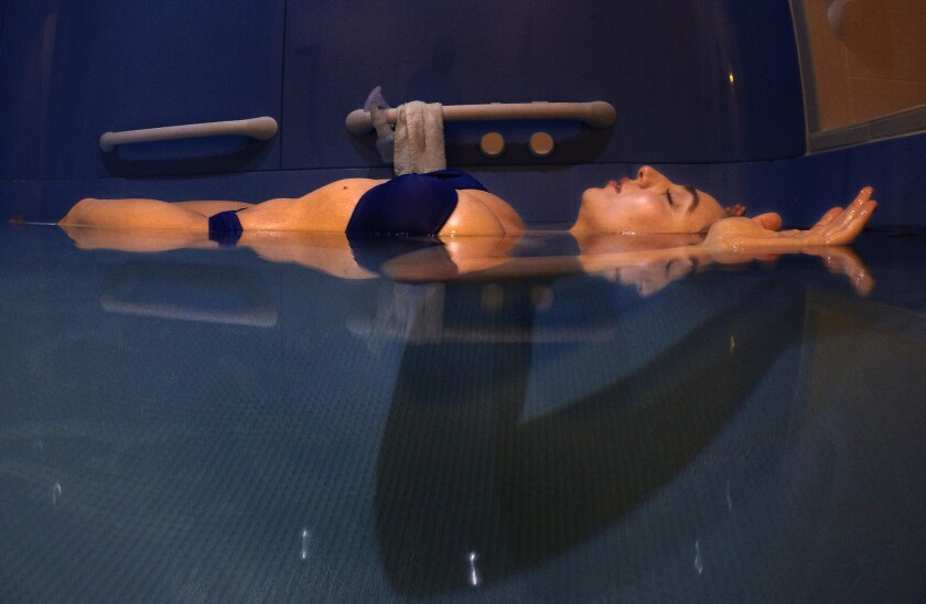 Ilona Houhanissyan, an employee at Just Float in Pasadena, floats in epsom salt, mixed in 11 inches of water, at a temperature of 94.5 degrees.