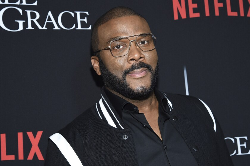 """FILE - In this Jan. 13, 2020, file photo, writer-director-actor Tyler Perry attends the premiere of """"A Fall from Grace"""" at Metrograph in New York. Perry wrote """"we must never give up"""" in a heartfelt first-person essay in People magazine detailing his thoughts on racial injustice and police brutality against unarmed black people in America. Perry said he almost passed on publishing his essay in the upcoming issue, which will be released Friday, but the filmmaker felt compelled to follow through because he's """"exhausted"""" from what he's recently seen across the country. (Photo by Evan Agostini/Invision/AP, File)"""