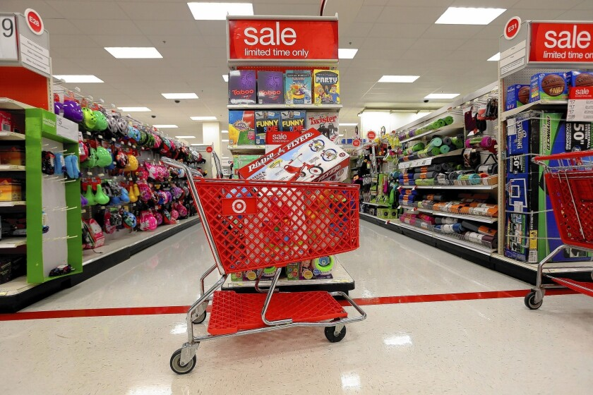 Target's sales hurt by hacking during holidays