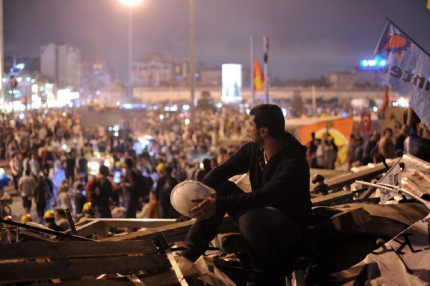 An antigovernment protester looks toward Taksim Square from Gezi Park in Istanbul, Turkey.