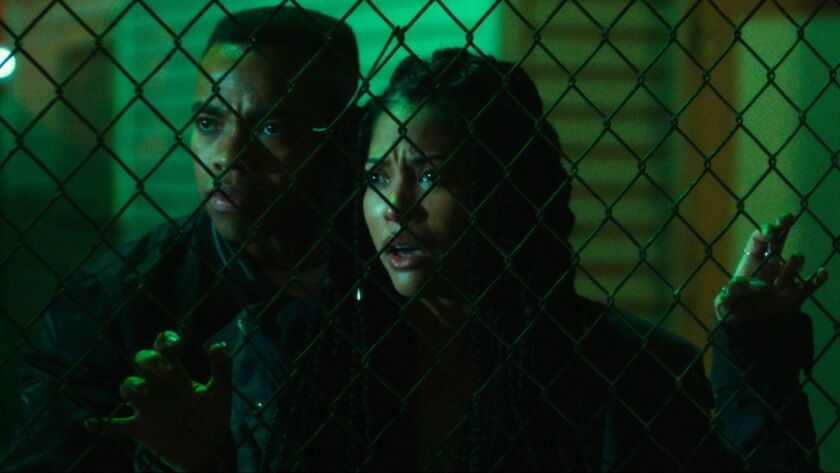 """Joivan Wade and Lex Scott Davis in """"The First Purge"""" movie."""