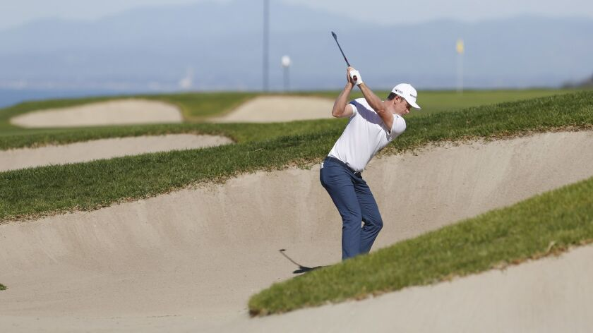 Justin Rose hits out of a bunker on the fourth hole during the third round of the Farmers Insurance Open. Rose's shot hooked into the canyon, leading to a double bogey.