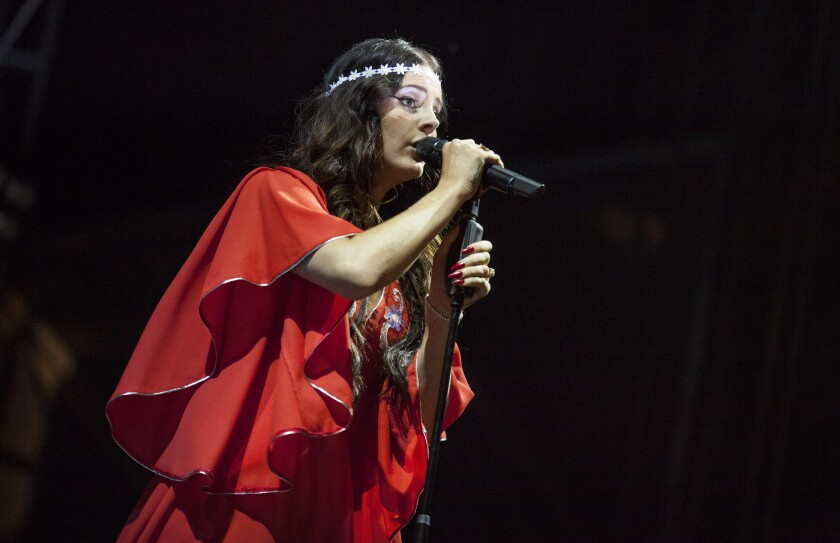 "Lana Del Rey performs during the 2013 Lollapalooza festival at Chicago's Grant Park. In 2017, the now-34-year-old singer and songwriter recorded the song ""Coachella — Woodstock in My Mind."""