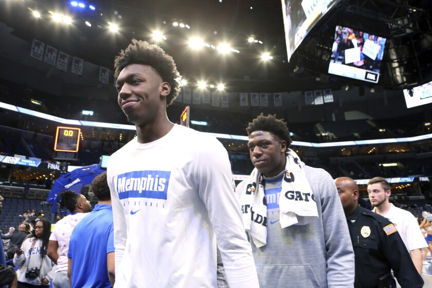 Memphis' James Wiseman walks off the court at the end of an NCAA college basketball game against Alcorn State Saturday, Nov. 16, 2019, in Memphis, Tenn. (AP Photo/Karen Pulfer Focht)