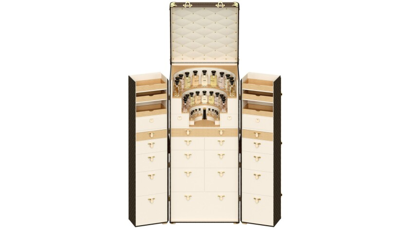 Louis Vuitton leather perfume trunk for fragrance connoisseurs, crafted with slots for 32 fragrance bottles (sold separately), approximately $123,000 by special order; contact Louis Vuitton in Beverly Hills, (310) 859-0457.