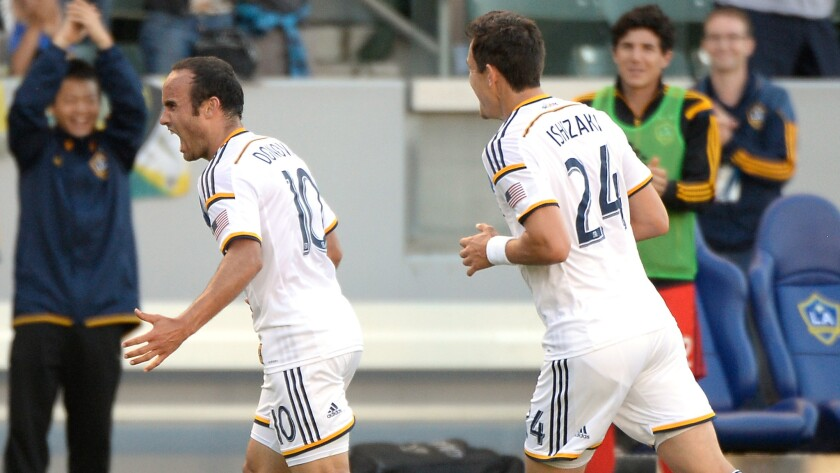Galaxy forward Landon Donovan, left, celebrates along with teammate Stefan Ishizaki after scoring his second goal of the game in a 4-0 win over the Philadelphia Union on Sunday.