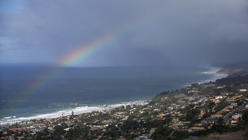 A rainbow out in the the ocean of La Jolla on a rain, windy Christmas Day on Dec. 25, 2018. (Photo b