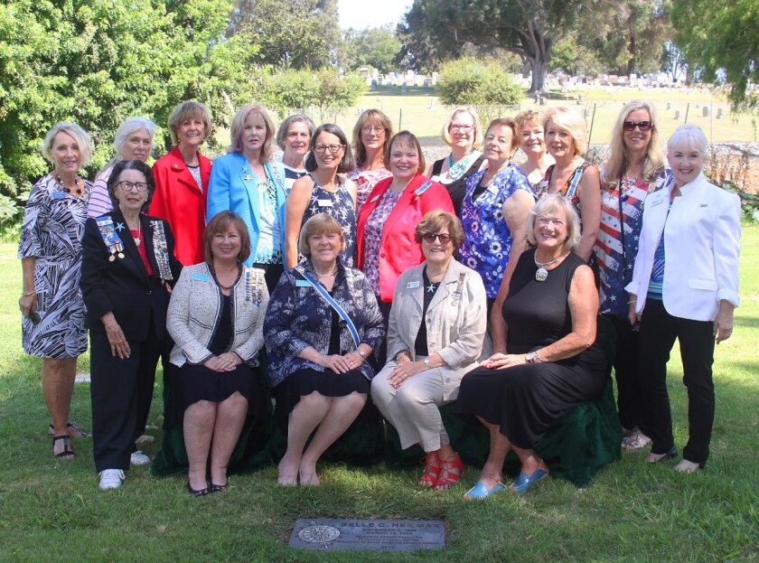 The Santa Margarita Chapter of the Daughters of the American Revolution, placed a DAR Insignia marked headstone on the gravesite of their Organizing Regent Belle C. Davis Heilman (1860-1952 ) at Mt. Hope Cemetery in San Diego. Heilman joined the San Diego Chapter NSDAR on December 6, 1922 and presented the Oceanside Chapter with its charter on October 26, 1929. The name was later changed to the Santa Margarita Chapter as the North County area grew. California DAR State Regent, Adele Lancaster, CSSDAR Recording Secretary, Lillian Leslie, District XIV Director, Rachel Jorgenson, were among the dignitaries attending the dedication ceremony. From left, seated Rachel Jorgenson, director of District IV; Adele Lancaster is DAR state regent; Charla Boodry is Santa Margarita chapter regent; Lillian Leslie is DAR recording secretary with members of the Santa Margarita Chapter.