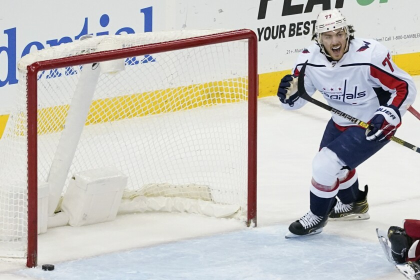 Washington Capitals right wing T.J. Oshie reacts after defenseman John Carlson scored during the second period of the team's NHL hockey game against the New Jersey Devils, Friday, April 2, 2021, in Newark, N.J. (AP Photo/Mary Altaffer)