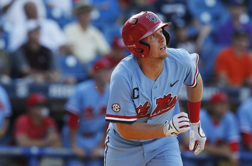 Mississippi's J.B. Woodman looks up at the ball after he hit a solo home run during the third inning against Vanderbilt in a Southeastern Conference NCAA college baseball tournament game at the Hoover Met, Thursday, May 26, 2016, in Hoover, Ala. (AP Photo/Brynn Anderson)