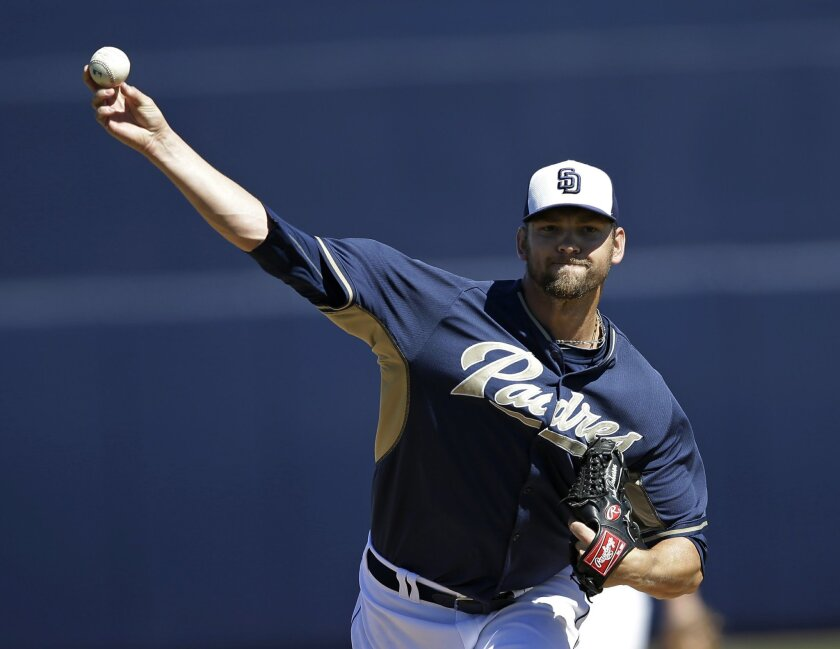 San Diego Padres starting pitcher Josh Johnson throws before an exhibition spring training baseball game against the Cleveland Indians Saturday, March 8, 2014, in Peoria, Ariz. (AP Photo/Darron Cummings)