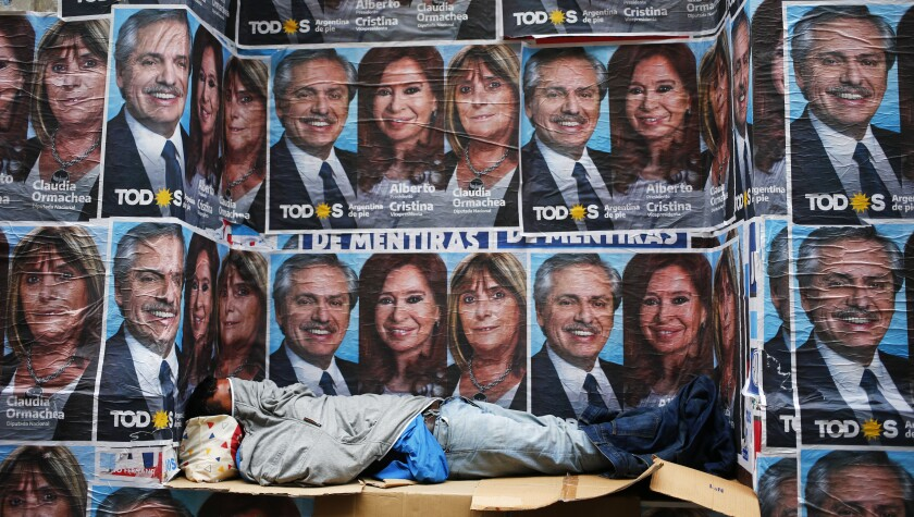 Posters advertise the winning Argentine ticket represented by Alberto Fernandez and Cristina Fernandez in Buenos Aires on Oct. 28, 2019.