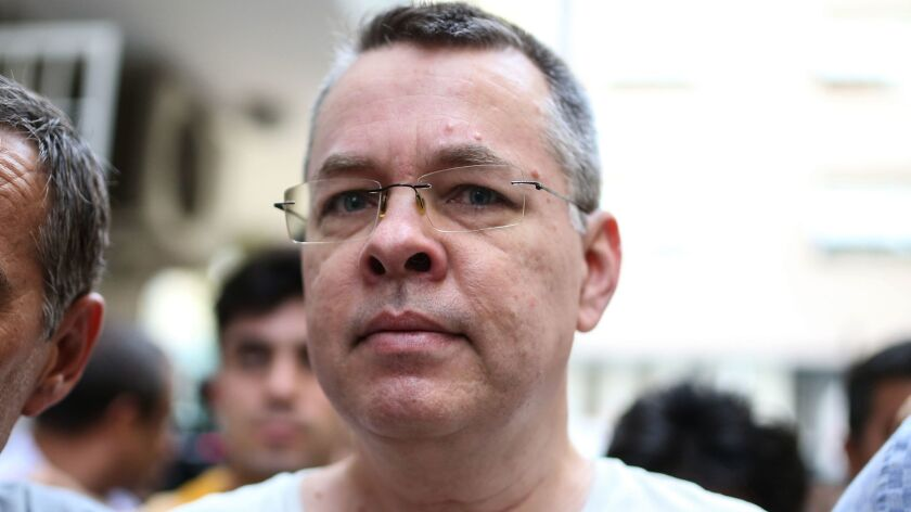 U.S. pastor Andrew Brunson is escorted by Turkish police officers to his house in Izmir.