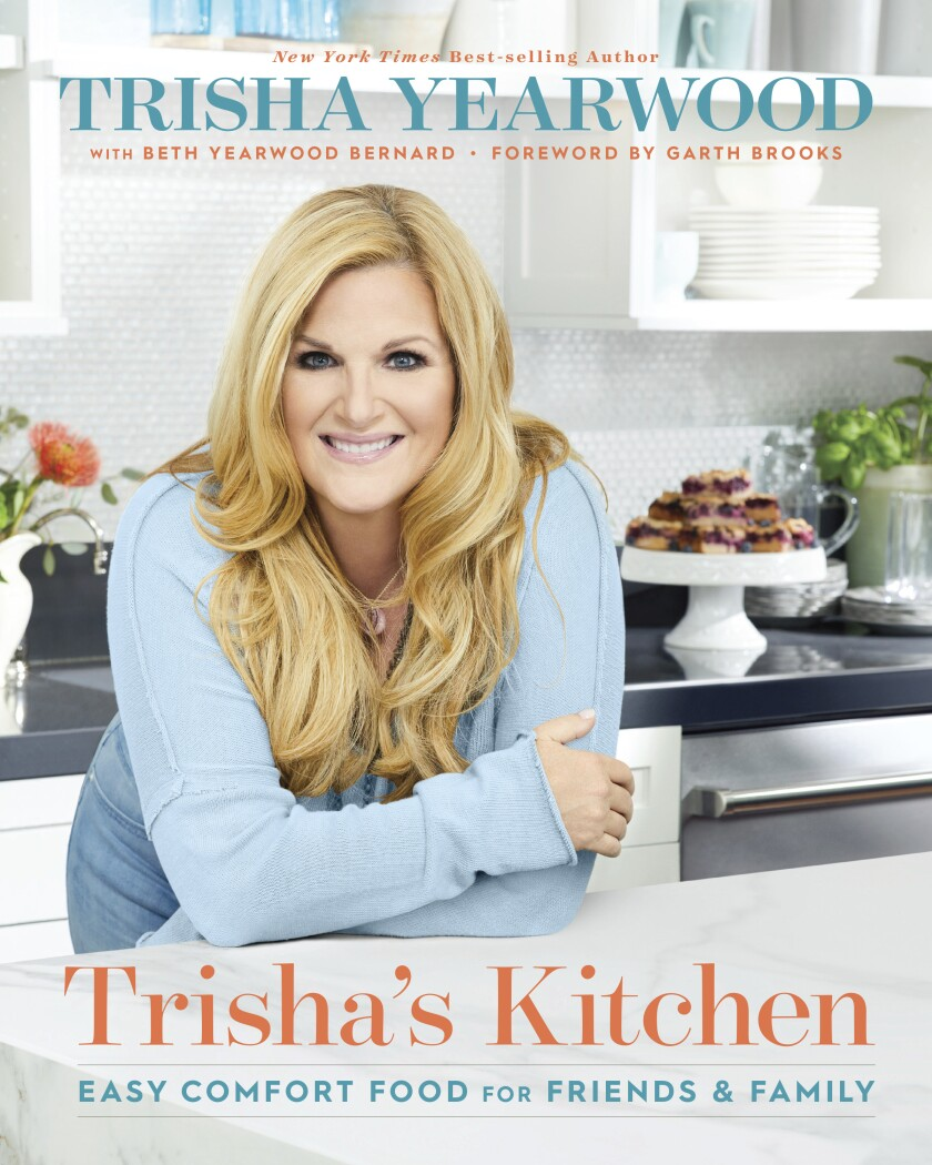 """This cover image released by Mariner Books shows """"Trisha's Kitchen: Easy Comfort Food for Friends and Family"""" by Trisha Yearwood. (Mariner Books via AP)"""