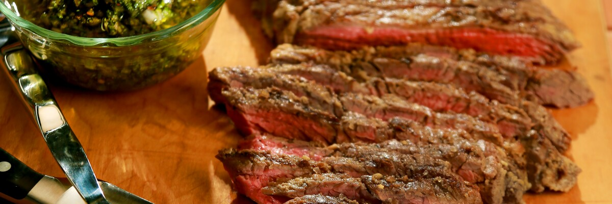 Skirt steak with chimichurri sauce.