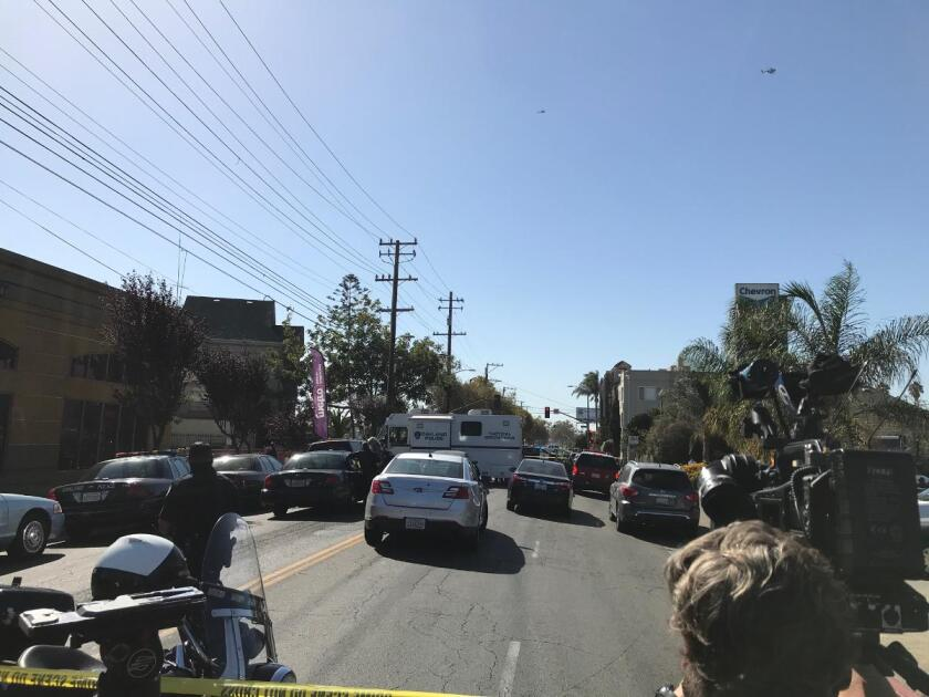 Cars block off a street in Oakland.