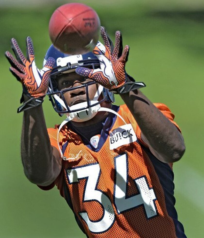Broncos defensive back Quentin Jammer participates in a drill during practice Thursday.