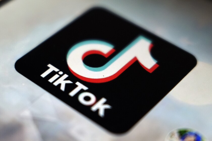 FILE - The TikTok app logo appears in Tokyo on Sept. 28, 2020. A federal judge has blocked President Donald Trump's attempts to ban TikTok, the latest legal defeat for the administration as it tries to wrest the popular app from its Chinese owners. (AP Photo/Kiichiro Sato, File)