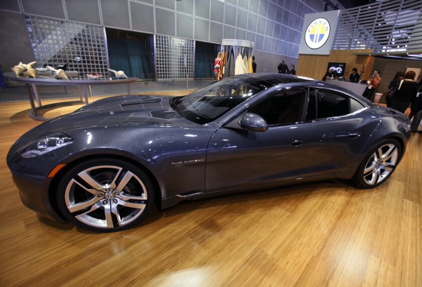 FILE - This Nov. 18, 2010 file photo shows the Fisker Automotive's Fisker Karma, a sports luxury plug-in hybrid car at the 2010 Los Angeles Auto Show in Los Angeles. Chinese auto parts conglomerate Wanxiang Group Corp. has increased its offer for Fisker, heating up the fight for the failed electric-vehicle maker by sweetening its bid with an additional $10 million in cash. But Fisker wants a Delaware bankruptcy judge to approve a private sale to Hybrid Technology LLC, which is owned by Hong Kong billionaire Richard Li. (AP Photo/Damian Dovarganes, File)