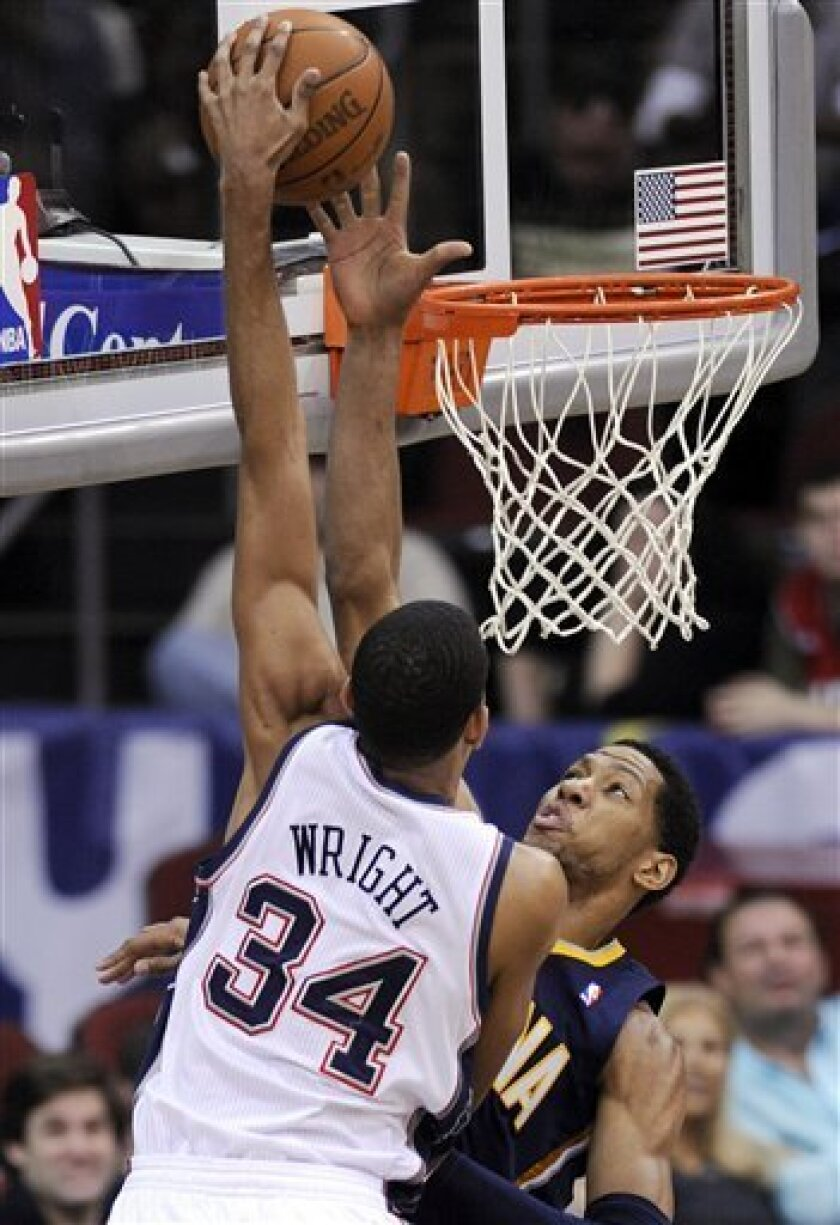 New Jersey Nets' Brandan Wright (34) attempts to dunk over Indiana Pacers' Danny Granger during the second quarter of an NBA basketball game Monday, March 21, 2011, in Newark, N.J. (AP Photo/Bill Kostroun)