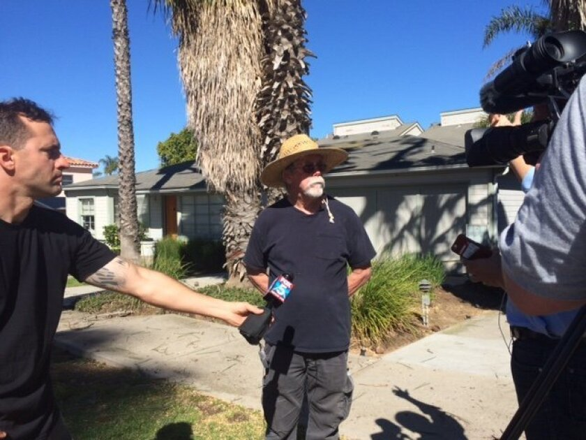 Ocean Beach resident Geoff Page talks to media about why he blocked the city from cutting down two trees on Saratoga Ave.