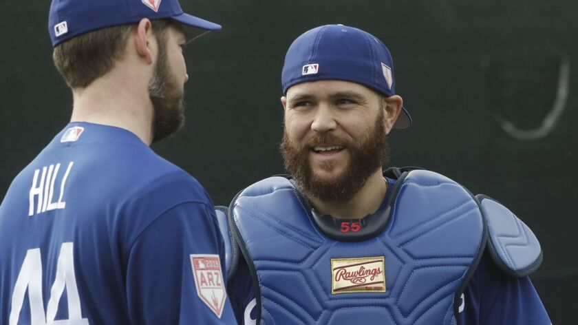 Los Angeles Dodgers catcher Russell Martin talks to pitcher Rich Hill during a spring training baseb