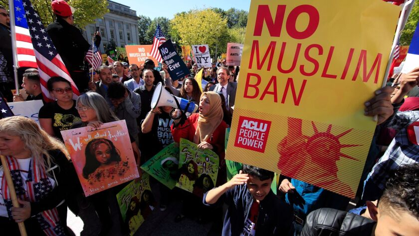 Protesters rally in Washington in October to decry President Trump's travel restrictions on visitors from Chad, Iran, Libya, North Korea, Syria, Venezuela and Yemen.