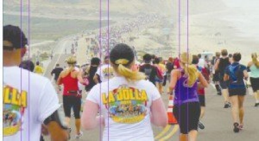 Thousands of runners follow the La Jolla Half Marathon course in 2013. It leads off from Del Mar Fairgrounds down Coast Boulevard through North Torrey Pines Park Road, North Torrey Pines Road and finishes at La Jolla Cove.  File