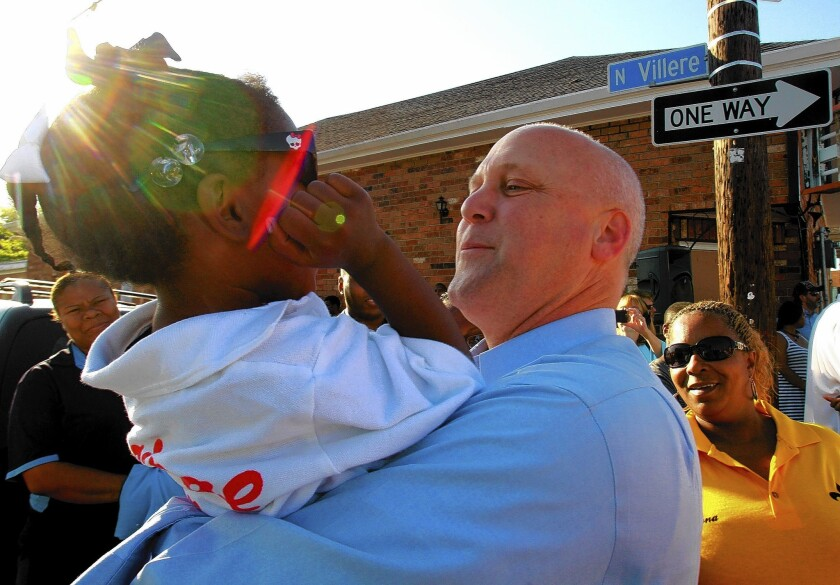 New Orleans Mayor Mitch Landrieu meets with constituents after a shooting last year.