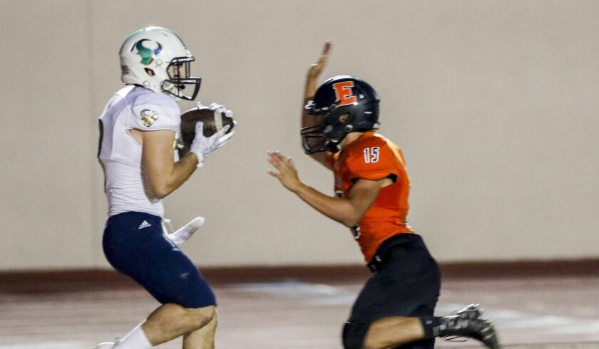 La Costa Canyon wide receiver Zach Goodkin pulls in a 21-yard touchdown pass from quarterback Jake Neufeld as Escondido's Wesley Huizar tries to defend. Goodkin also had a 61-yard run for the Mavericks.