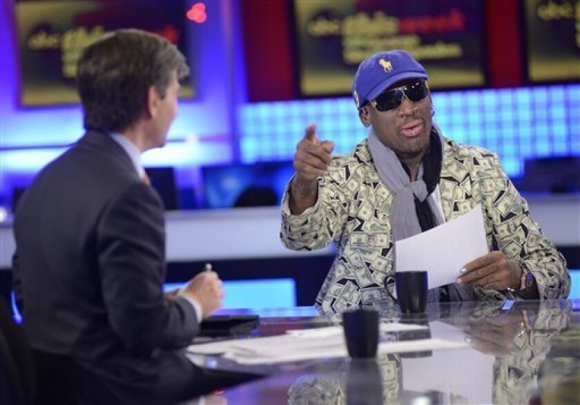 """In this Sunday March 3, 2013, photo provided by ABC television """"This Week"""" host George Stephanopoulos, left, interviews former NBA star Dennis Rodman, just back from a visit with North Korea's young leader Kim Jong Un, in studio in New York. Kim Jong Un doesn't really want war with the superpower, just a call from President Barack Obama to chat about their shared love of basketball, says erstwhile diplomat Rodman.""""He loves basketball. ... I said Obama loves basketball. Let's start there"""" as a wa"""