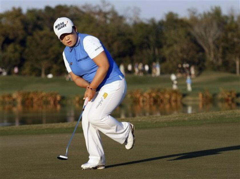 Jiyai Shin, of South Korea, reacts after missing a birdie putt on the 13th hole during the second round of the LPGA Tour Championship golf tournament Sunday, Nov. 22, 2009, in Richmond, Texas. Weather delays over the previous two days shortened the tournament to 54 holes which officials hope to finish on Monday. (AP Photo/David J. Phillip)