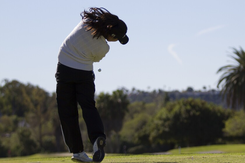 Pacific Ridge's Angela Ding tees off on the 11th hole at Admiral Baker golf course.