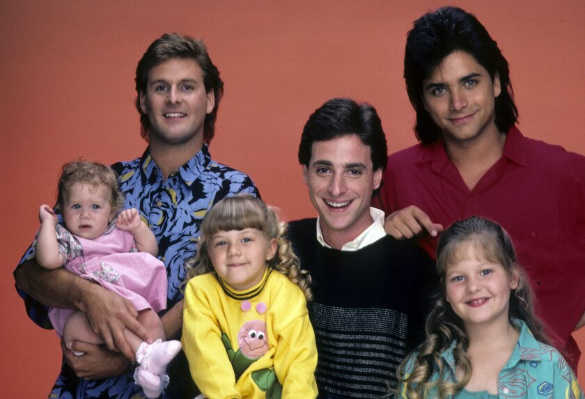 """Mary-Kate/Ashley Olsen, left, Dave Coulier, Jodie Sweetin, Bob Saget, John Stamos and Candace Cameron in a gallery shot from the """"Full House."""" A revival of the hit ABC sitcom will roll out on Netflix in February."""