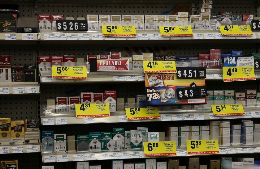 More than two dozen state attorneys general are urging retailers, including Walgreens and Wal-Mart, to stop selling tobacco. The requests comes less than two months after CVS Caremark Corp. said it would stop selling cigarettes, like those shown above in a California store.