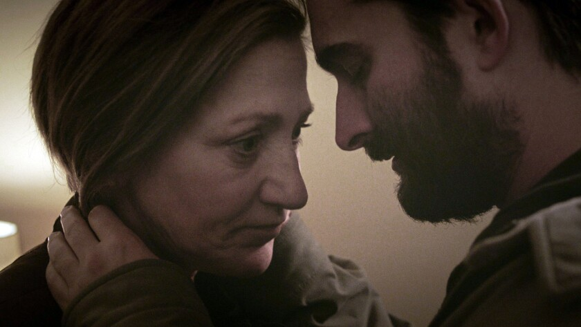 "Edie Falco and Jay Duplass in the movie ""Outside In."""