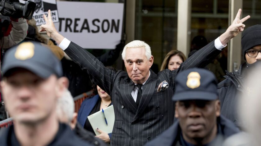 Roger Stone in February 2019 lifting his arms in a victory salute after earlier pleading not guilty to several charges.