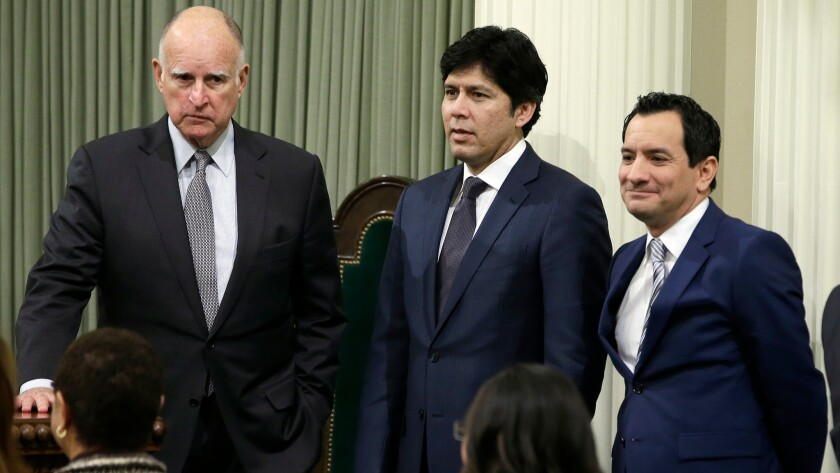 Gov. Jerry Brown, Senate President Pro Tem Kevin de León and Assembly Speaker Anthony Rendon mingle in Sacramento in March. Their budget compromise could help pay for the construction of more affordable housing across the state.