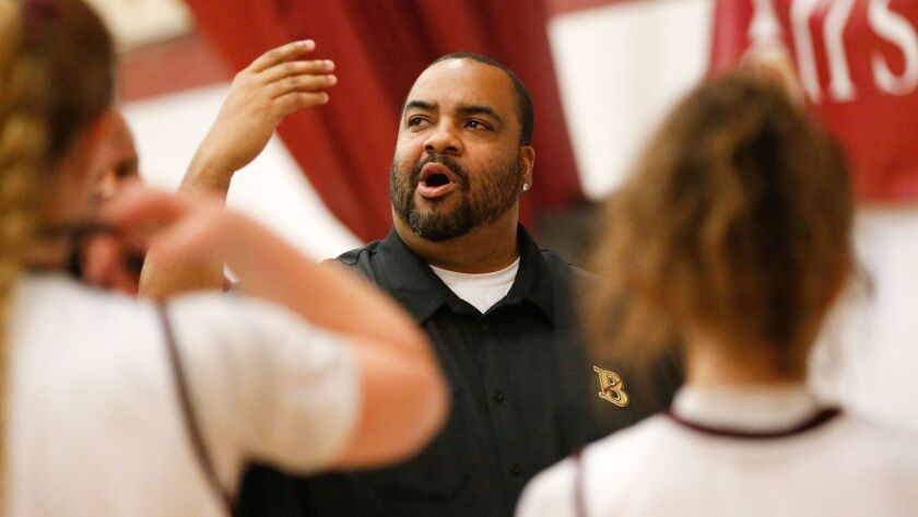 Marlon Wells has coached both Destiny Littleton and record-holder Charde Houston during his long career.