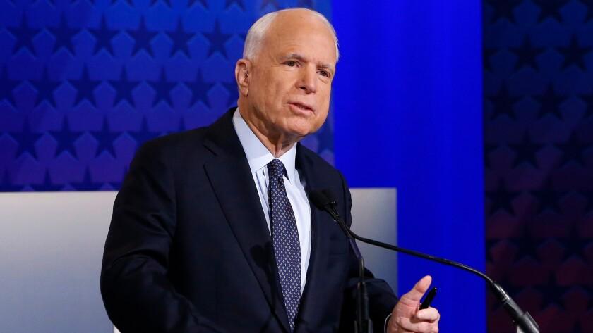 Arizona Republican Sen. John McCain speaks with debate moderators prior to a debate with Democratic Rep. Ann Kirkpatrick on Oct. 10 in Phoenix.