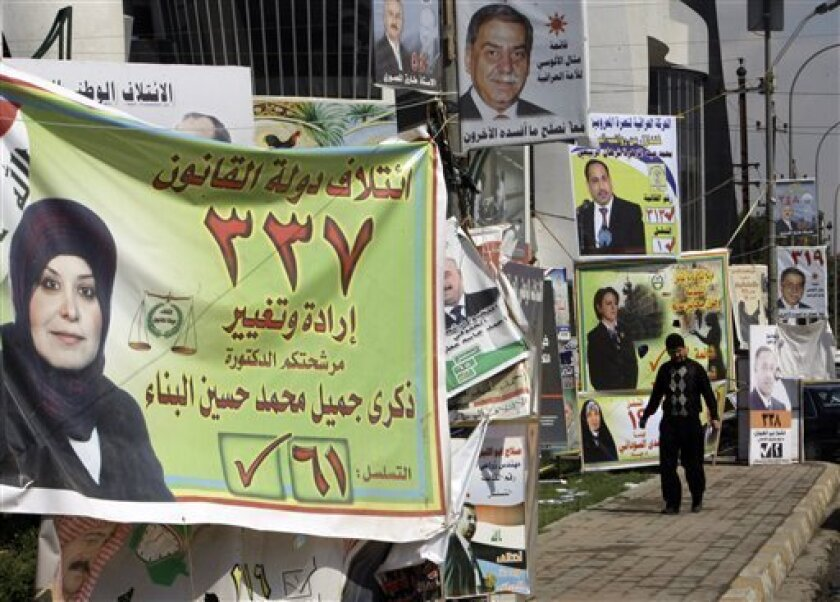 Election campaign posters for many candidates are seen along a street in Baghdad, Iraq, Monday, March. 1, 2010. Iraq's national election is set for March 7. (AP Photo/Khalid Mohammed)