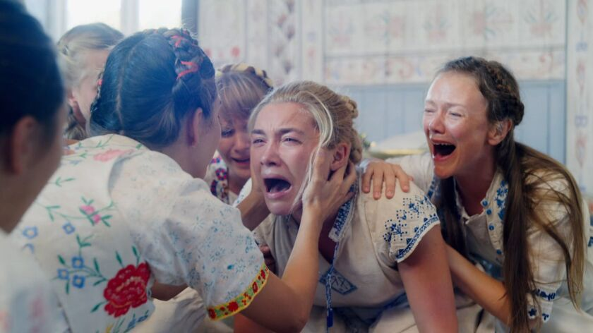 "Florence Pugh's Dani, center, is dealing with grief after a family tragedy, in ""Midsommar."""