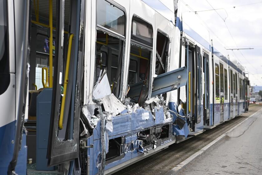 A tram that was hit by a truck ist pictured in Zurich, Switzerland, Monday, Oct. 12, 2020. Several passengers were injured in the accident. (Ennio Leanza/Keystone via AP)