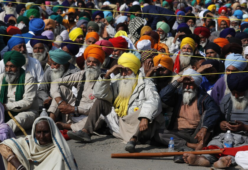 Indian farmers hold a meeting at the Delhi-Haryana state border, India, Sunday, Nov. 29, 2020. Protesting farmers on Sunday rejected the Indian government's offer to hold immediate talks if they ended their blockade of key highways they've held as they seek the scrapping of legislation they say could devastate crop prices.(AP Photo/Manish Swarup)